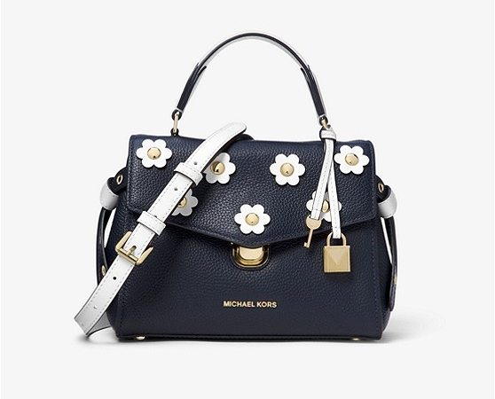 The Bristol Floral Appliqué Leather Crossbody retails for $328.00 on the Michael Kors website.
