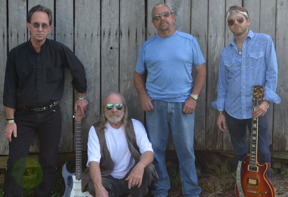 From left, Myke Carroll (lead guitar), M. D. Marine (bass, lead vocal), Johnny Weaver (drums), Muddy Welles (slide guitar)