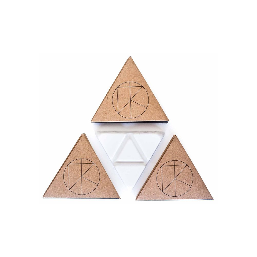 Palo santo infused Surf wax - $6 - Give a gift that never goes to waste. These unique waxes are infused with oil from the Palo Santo tree to bring good vibes, energy cleansing and healing benefits out on the water. And their unique triangle shape means you can snap a piece off and save the rest for later.Get it on CURIO