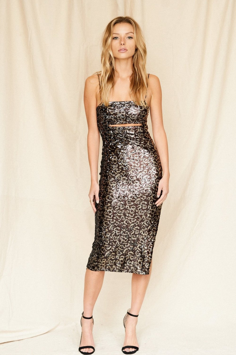 Celine Leopard Sequin Dress -12th Tribe - There is no better feeling than confidence and wearing the Celine Leopard Sequin Dress will definitely have you feeling that way. A sexy and tight fitted dress that flirts its way to the dance floor. You'll feel the best you've ever felt in this hot number.