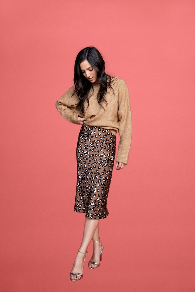 $98 GABY MIDI SKIRT - LEOPARD (BETWEEN TEN) - The perfect skirt to wear with sneakers during the day and change to heels in the evening. Try it with your favorite graphic tee or sweater.