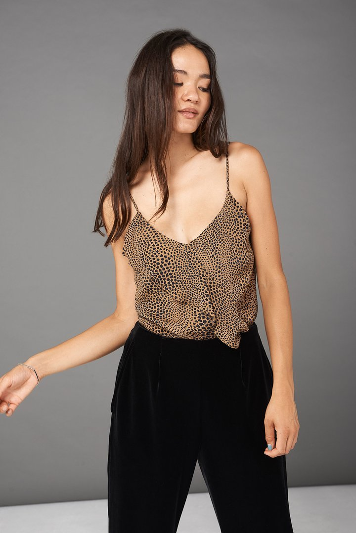 $76 Emily Ruffle Cami in Cheeta (Whimsy + Row) - When you're looking for effortless chic, look no further. This go to cami has adjustable straps and built-in shelf bra for extra coverage. Throw it on with a pair of black pants and you're set for the whole day.