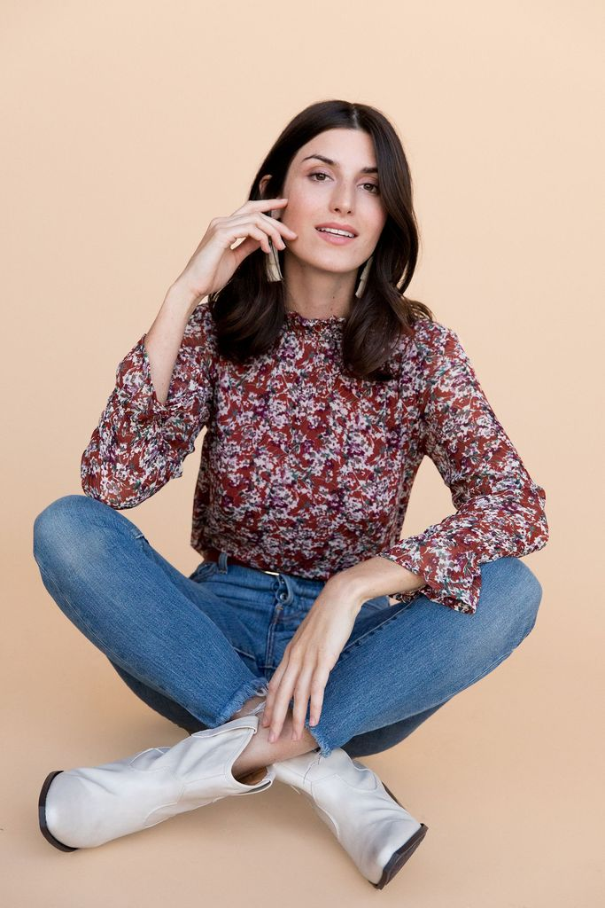 $118 Andi Blouse - Merlot Floral (Between Ten) - This chic blouse features an elastic neckline and elastic wrist detail with bell sleeves making it a trendy and casual day top that can transition well for dinner plans in the evening.
