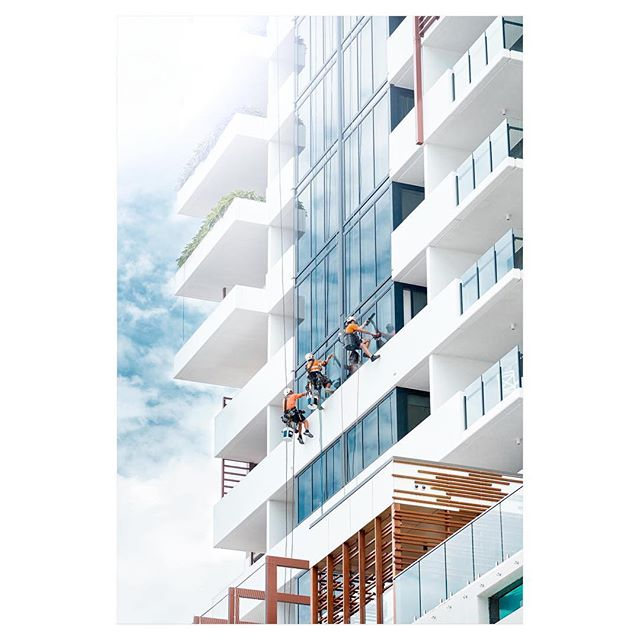 Window washers clean the outside of an apartment building in South Brisbane.