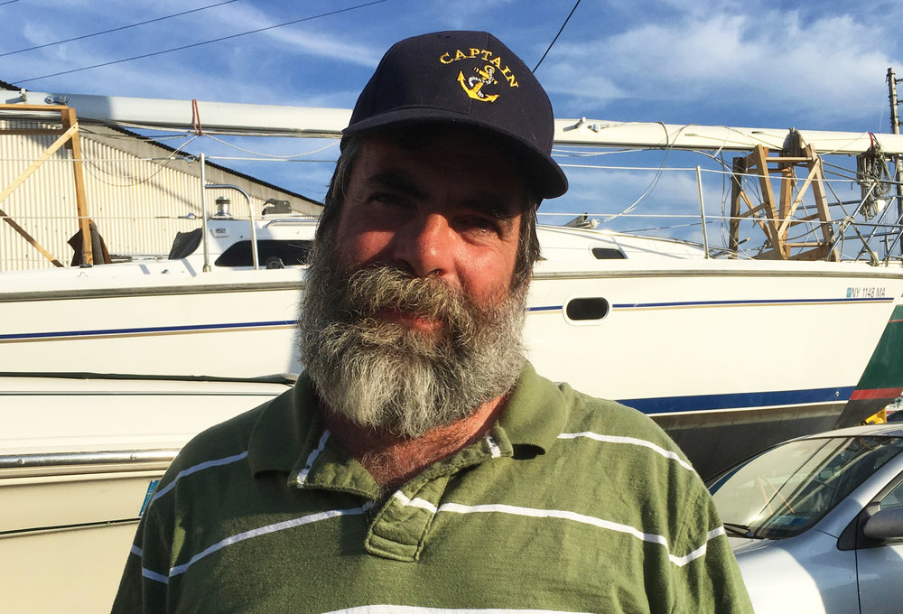 Captain Woody - Woody is your trusted and experienced Captain, with 15 years of experience sailing and a commercial license to charter sailboats. After coming to Ithaca in 1983 to attend Ithaca College, Woody sailed all over the world — from the Great Lakes to the Mediterranean and everywhere in between.