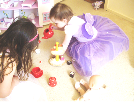 Problem Solving / Play   We focus on your child's ability to:  - engage in pretend play that imitates situations that are highly familiar (e.g. brushing hair or eating some food).   We will also be looking to see if your child is beginning to use objects 'symbolically' in play (e.g. holding a cup to their ear pretending it is a phone).