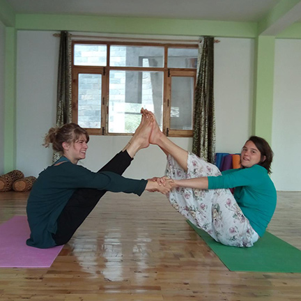 Julie (left) with her friend in the yoga studio