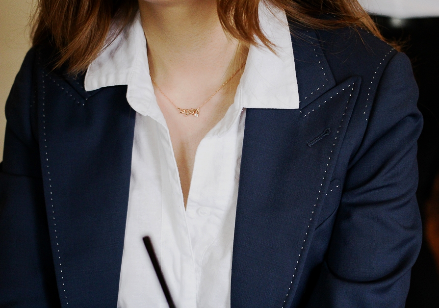 OUR PEAK LAPEL WITH WHITE PIC STITCHING DETAILS.