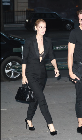 Celine Dion wore a black suit without a shirt underneath.