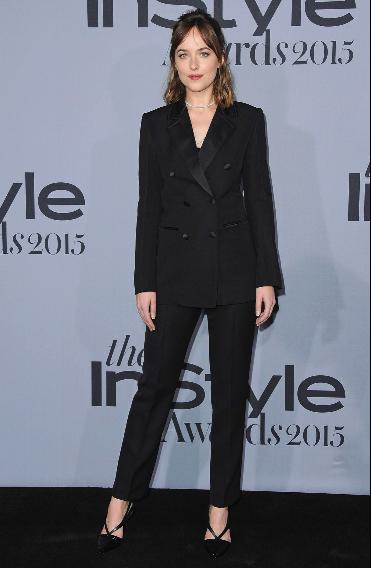Dakota Johnson in her sharp black double breasted suit.