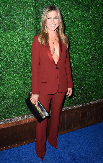 Jennifer Aniston wearing her Gucci Red Tuxedo without any lingerie or shirt underneath.