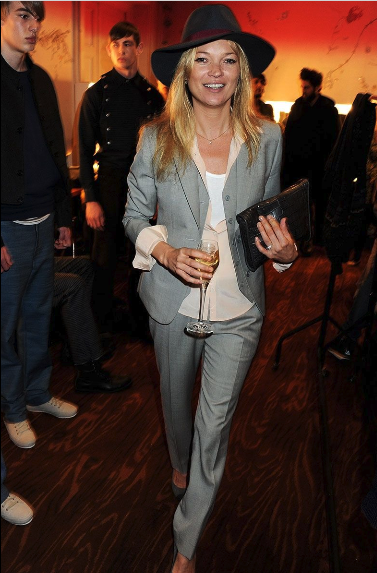 Kate Moss looking cool in her grey suit.
