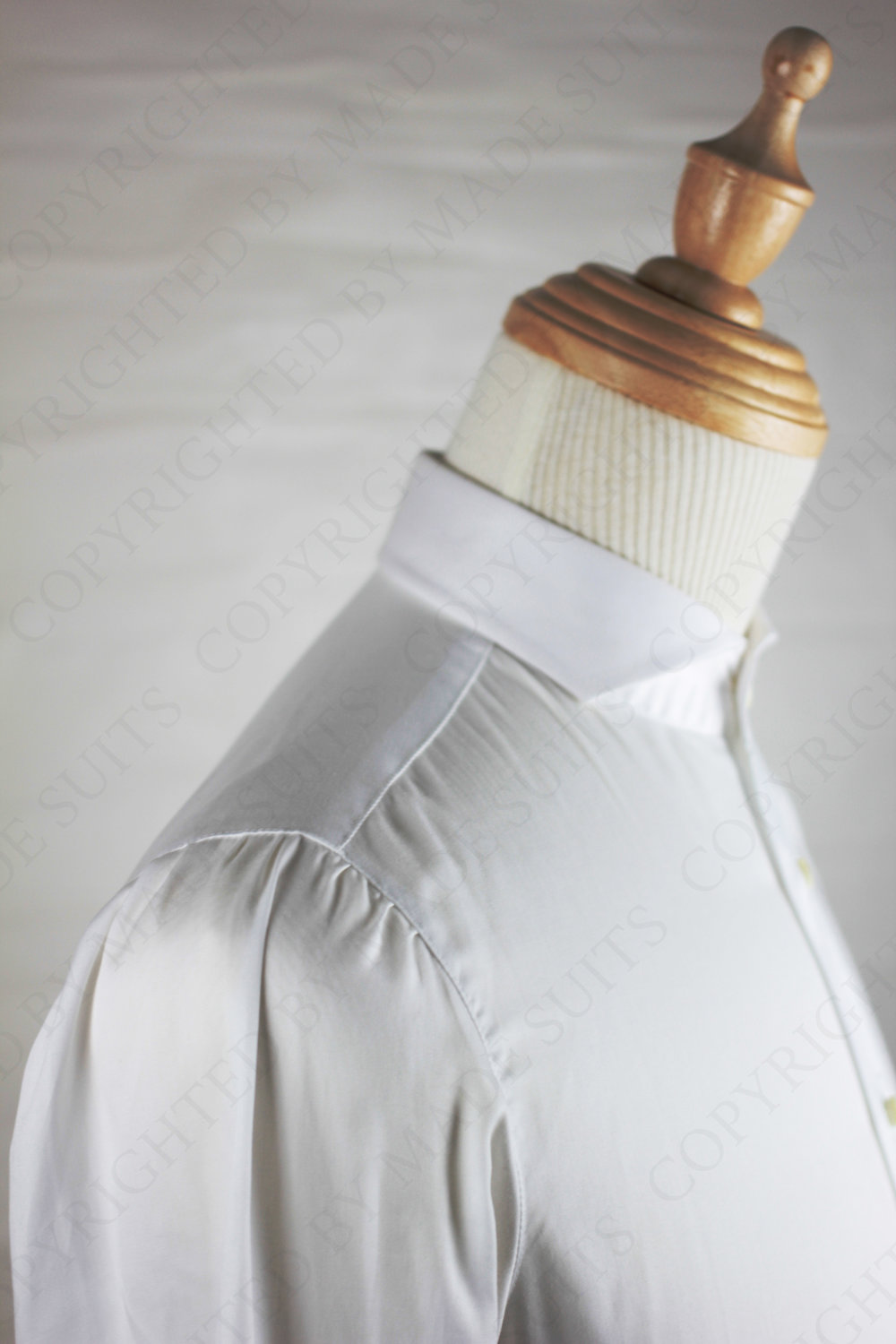 25 steps by hand our neapolitan shirt shoulders are unique and creates an ahletic look for the individual