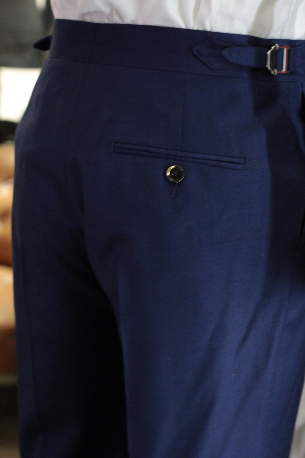 Slanted pockets with button back