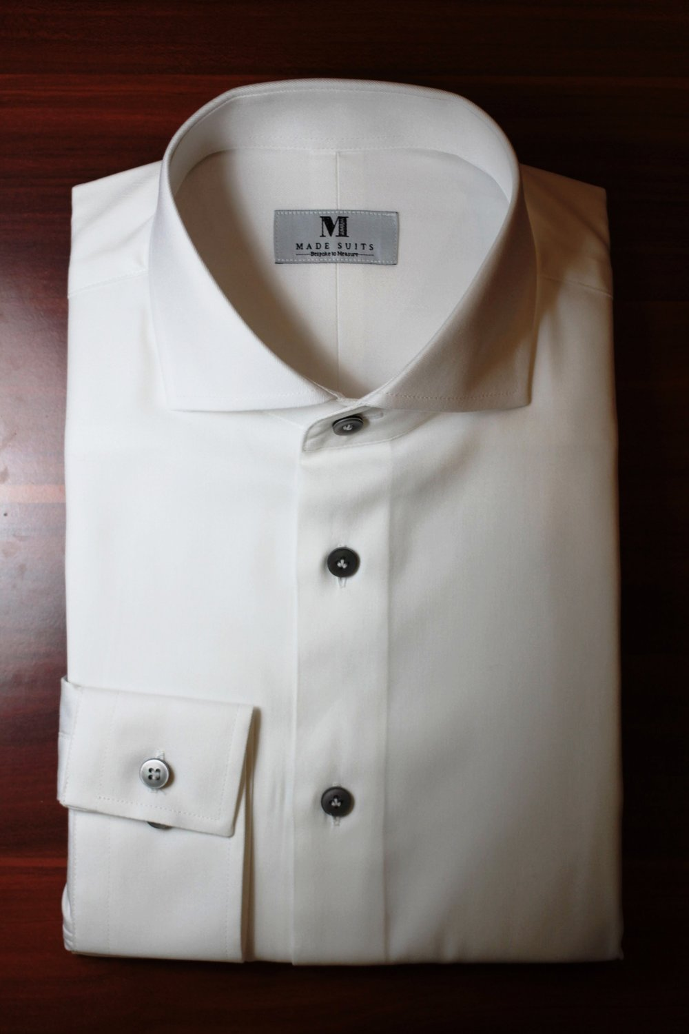 A Crisp white shirt made with Super Ginza Cotton Perfectly Cutaway Collar. #madesuits Signature