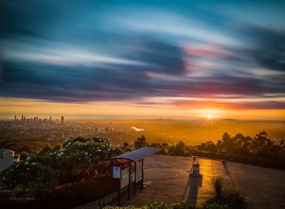The Golden Light of Brisbane   From Moreton Bay to Mt Cootha, the dawn sun bathes the city in light as the clouds roll endlessly overhead.   Purchase