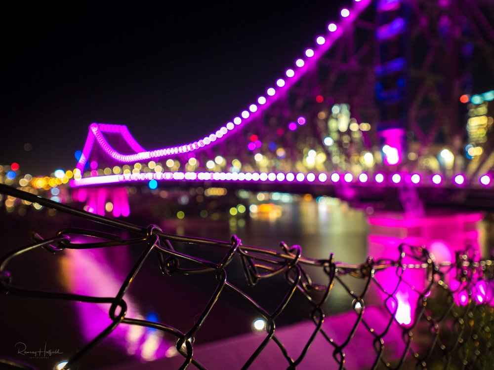 Purple Haze in the City   The purple light of Brisbane's Story Bridge reflects off the wire.        Purchase