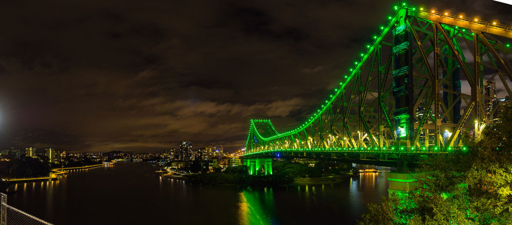 An Evening in Brisbane   The sweep of the Brisbane River accompanied by a green Story Bridge.    Purchase