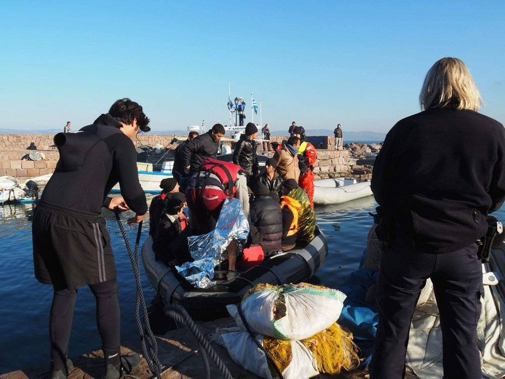 Assisting refugees arriving in Skala Sikamineas port in winter.