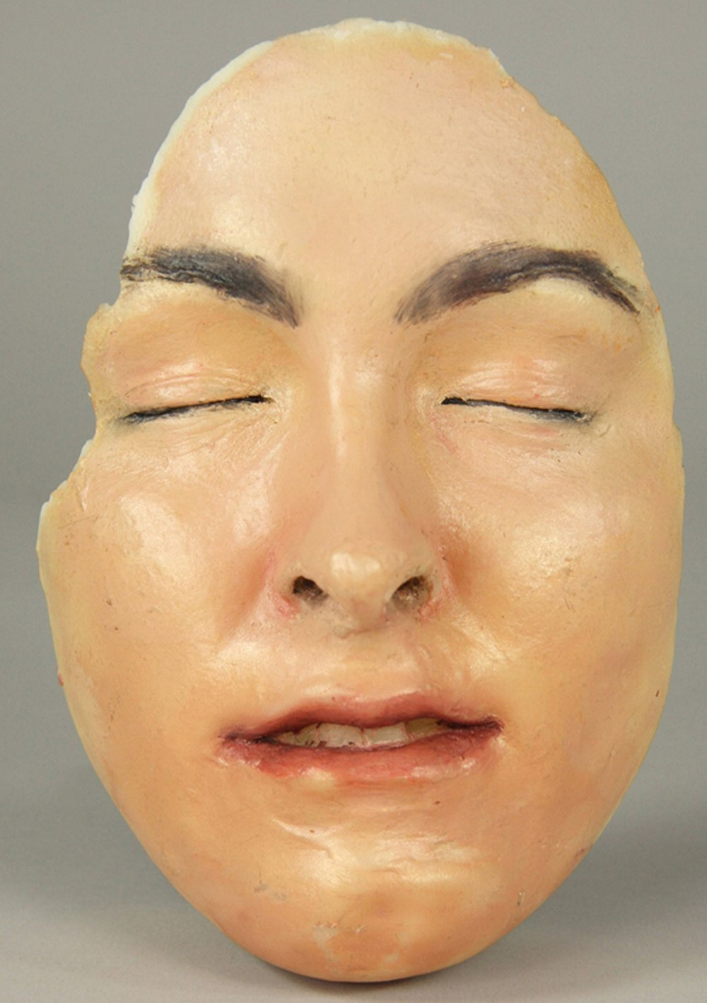 "10. Mask of K. McGrath. Cast wax, oil paint, 8 ¼ ""x 6"" x 4"", 2011..jpg"