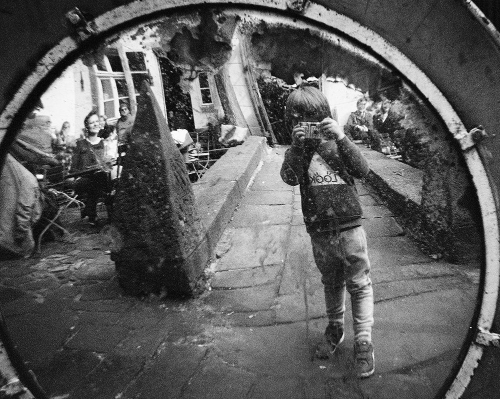 Photo credit: selfie by four years old Nika on Ilford xp2 Single Use Camera    proof that you also can ;)