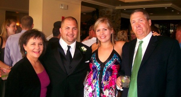 From left: my mom, my brother, me, and my dad at a friend's wedding in 2009