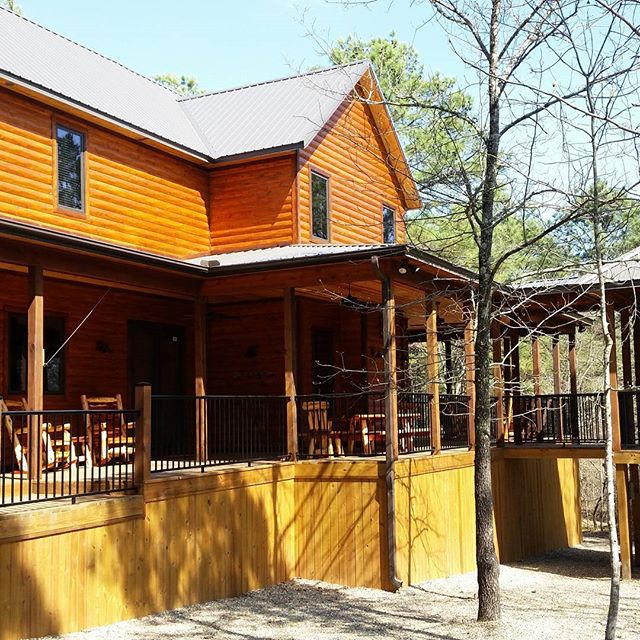 A partial  few of the outside living area at Call It A Day cabin.  Book now at www.brokenbowlakewoodluxurycabins.com.