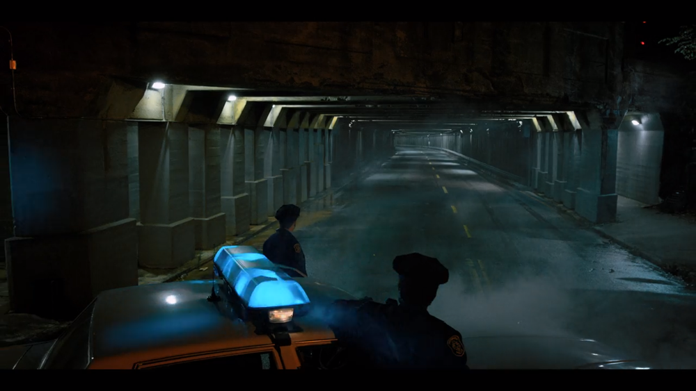 Police officers stare mesmerised into a seemingly long tunnel after having lost track of a strangely gifted gangster squad. Image courtesy of Netflix (and the  Duffer Brothers ).
