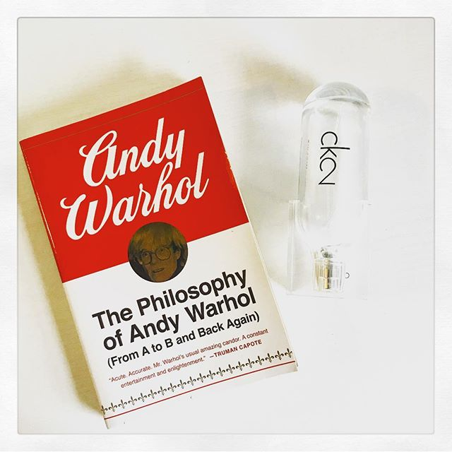 """I've mentioned the phase I went through where I read every and any book """"by"""" / about Andy Warhol. Well this is one of the casualties of that obsession. Slightly autobiographical, but for the most part this quick-read is just tangents. Instead of covering specific events in his life, each chapter focuses more on general ideas and topics like beauty, sex, New York and America. It's not my favorite, but it is interesting * * * Calvin Klein is brand that epitomizes American culture, similar to Campbell's. These types of pop culture phenomenons are exactly what peaked Warhol's interest. As for this fragrance, CK2 is a uni-sex scent that is fresh, clean and absolutely lovely (AKA my daily-wear). Not to mention, the pop artist is known for loving beautiful things and this sculpture-looking bottle is nothing if not beautiful.* * * * * *#beauty #books #bookstagram #beautygram #booksandbeauty #bibliophile #calvinklein #andywarhol #fragrance #ck2 #perfume"""