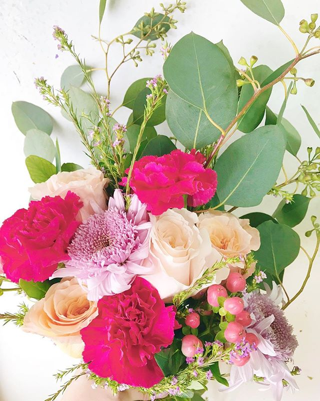 """Don't be like the rest of them darling!"" -Audrey Hepburn This happy charmer is now available to order! It's full of peach shimmer roses, gentle purple mums and diosma, with a pretty punch of pink carns and hypericum and seeded eucalyptus.  Each hand tied bouquet is $28 (plus tax) and will be ready for pick-up Friday morning at the lovely @jbandme36, Breton Village, Grand Rapids.  There are only a select number available... to order one of these lovelies, just DM or email and we'll get you taken care of! 💐 oh happy day!"