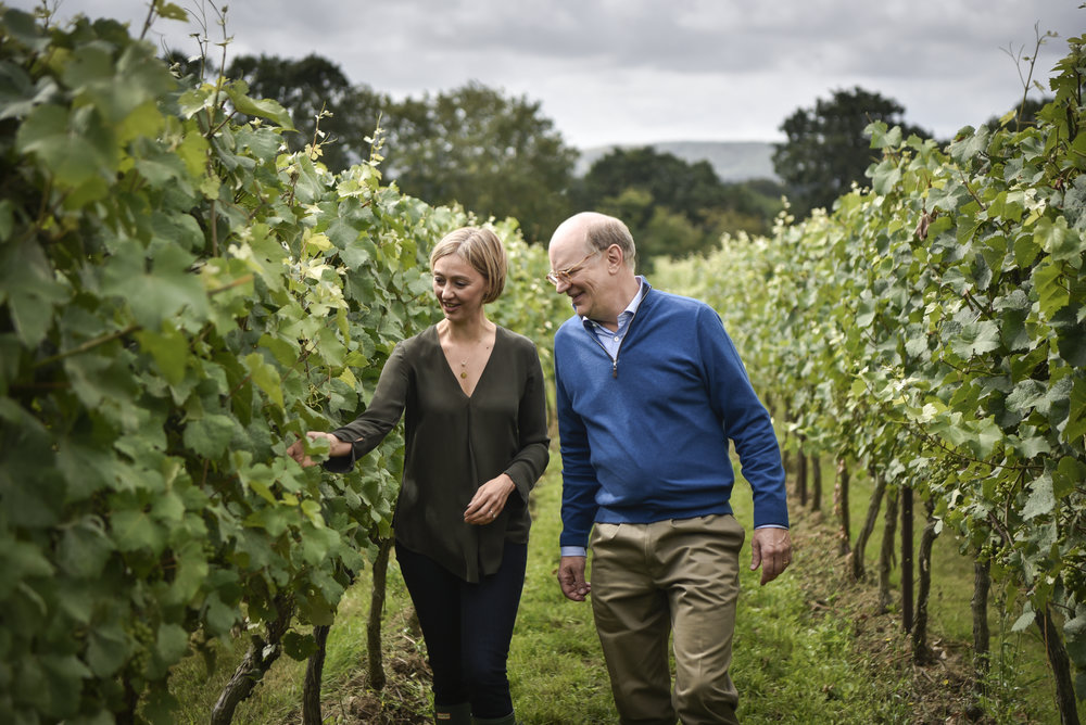 Cherie Spriggs and Eric Heerema in the Nyetimber Vineyards.jpg
