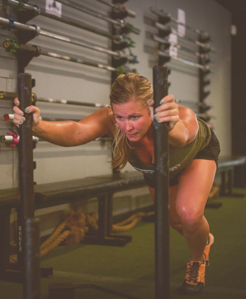 Coach Nikki   Specializations  CrossFit Level 1 Trainer  Nikki is a UNCC graduate originally from Fresno, California.  She has been CrossFitting since 2013, and fell in love with the sport after her first WOD.  You can usually find her with a smile on her face, especially when the workout involves a heavy barbell! Her favorite part about CrossFit is watching someone do something they never thought they could.