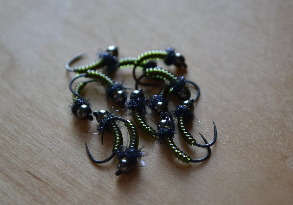 A very fast, simple, and easy caddis nymph. Excluding the thread and bead there are two materials: ribbing and a spot of black ice dubbing.