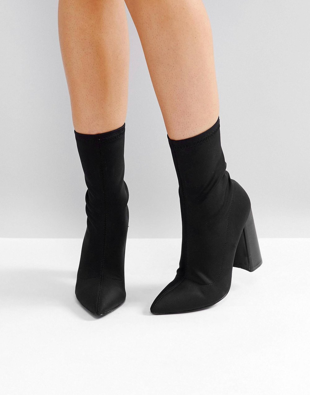 Black Sock Boots - Sock boots are a really cute and versatile trend! Wear with skinny jeans, with a skirt or dress, or peeking out from wide-legged cropped pants.
