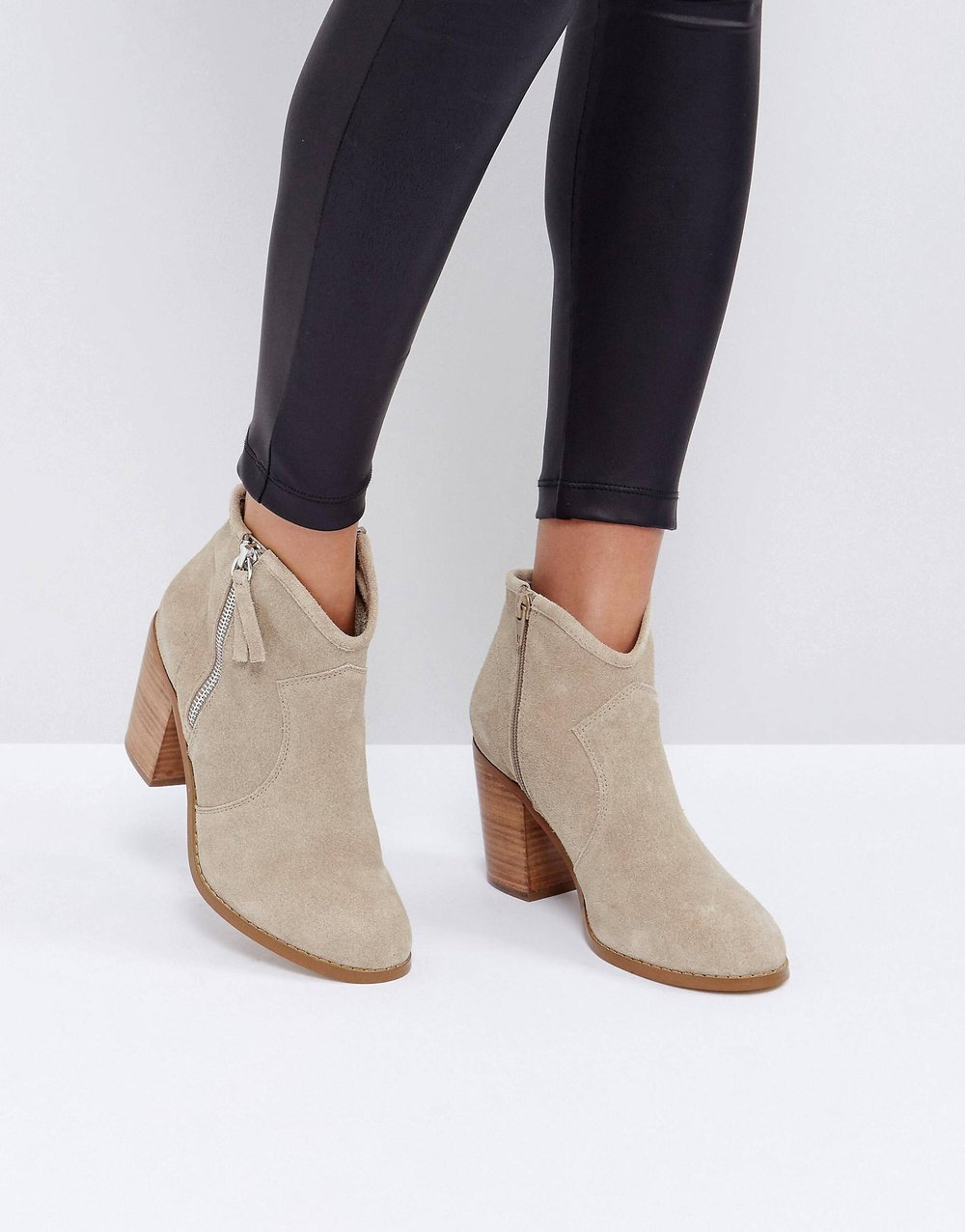 Tan Ankle Booties - Tan ankle booties are a great fall staple to wear with cozy sweaters and scarves. I love how these booties have a little dip in the front - any boots with that feature help to elongate the look of your legs from the front!