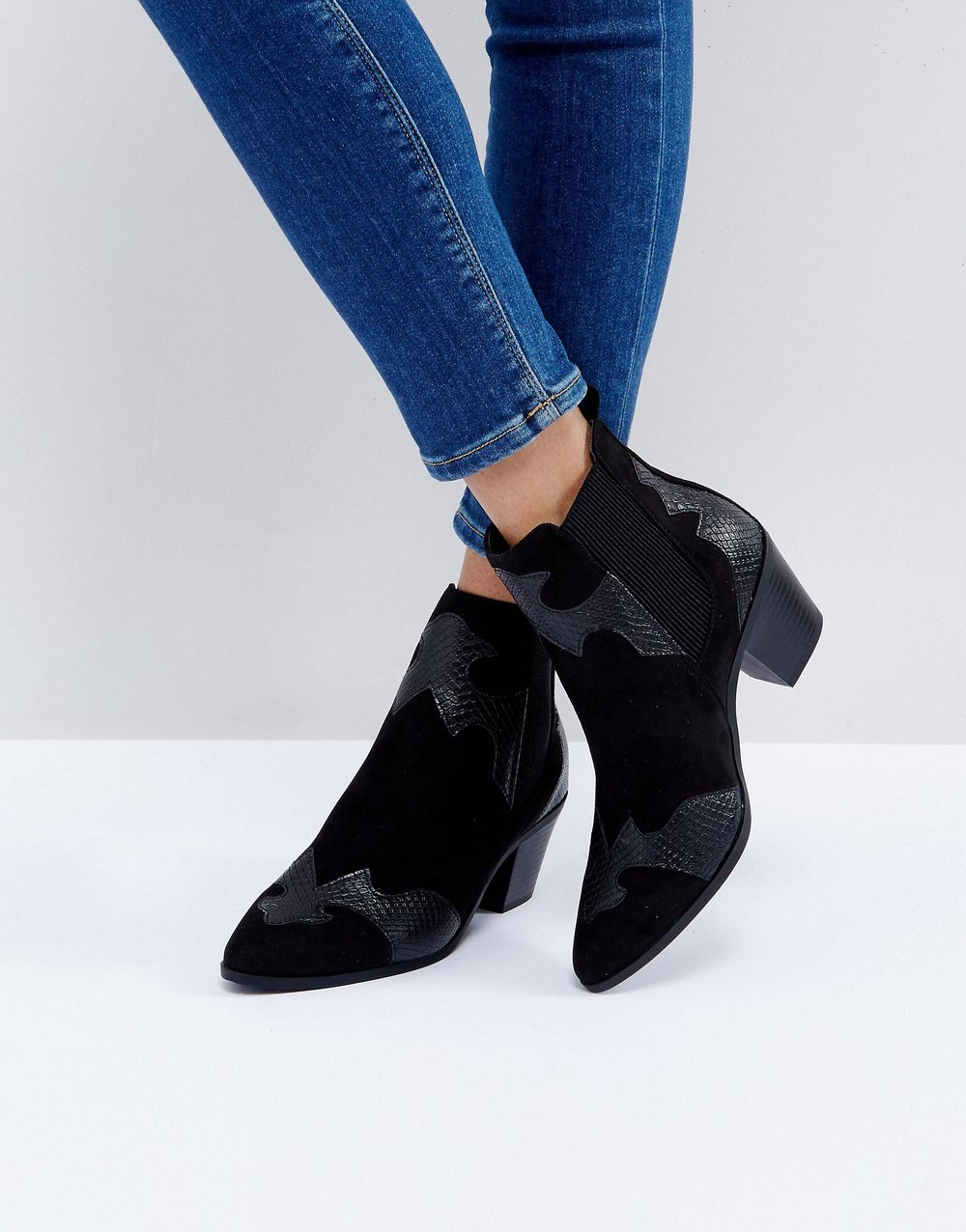 Black Western Booties - I love the western appliqué on these booties! It takes an average black ankle boot up to the next level. These are great every day booties for the fall, and would work well styled with a leather jacket or a cozy sweater!