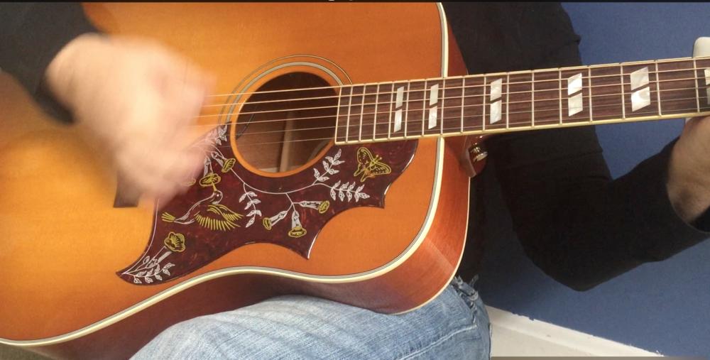 Playing Guitar 2019.png
