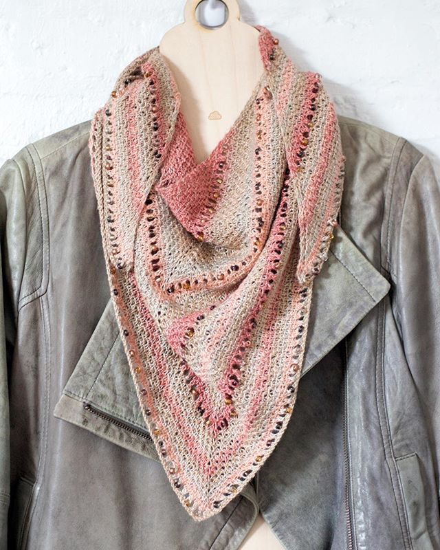 ETEREO _ a beautiful triangular shawl in silky fibers and glass beads dresses up an otherwise casual jacket and is a perfect transitional piece for spring. // color: Sunray pattern: Cascade Kerchief by knittimo / Sachiko Uemura available on Ravelry.