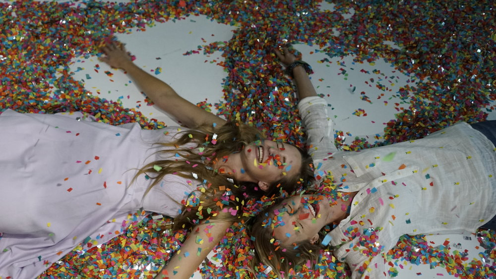 Carly and I trying not to eat any of the gross floor confetti.