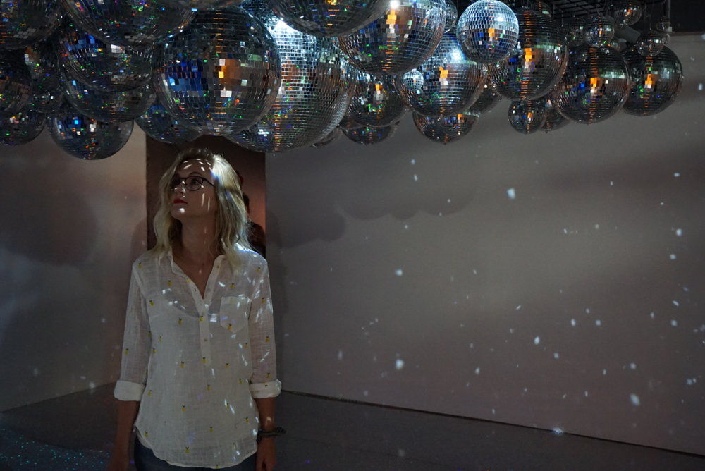 Stoic Carly in the disco ball room.