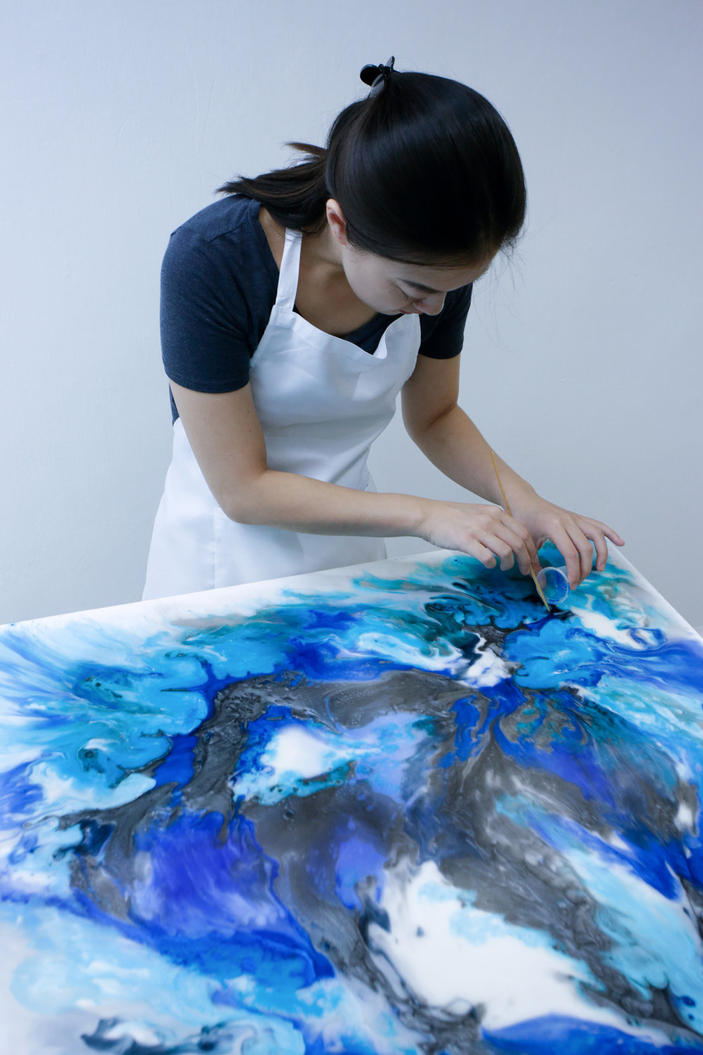 Mimi working on a Resin Canvas