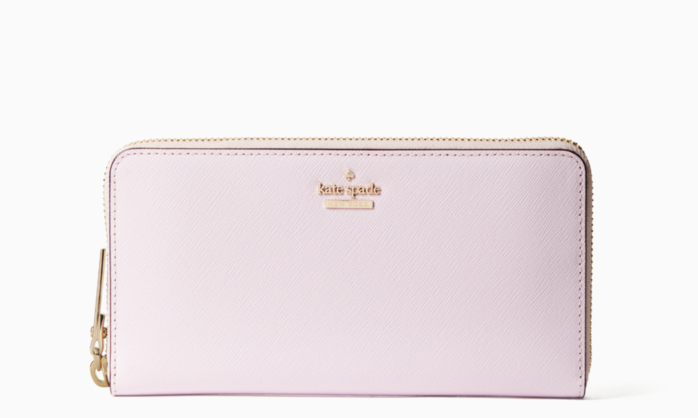 The wallet I bought at fifteen (though mine is a bit more worn).  Image via  Kate Spade
