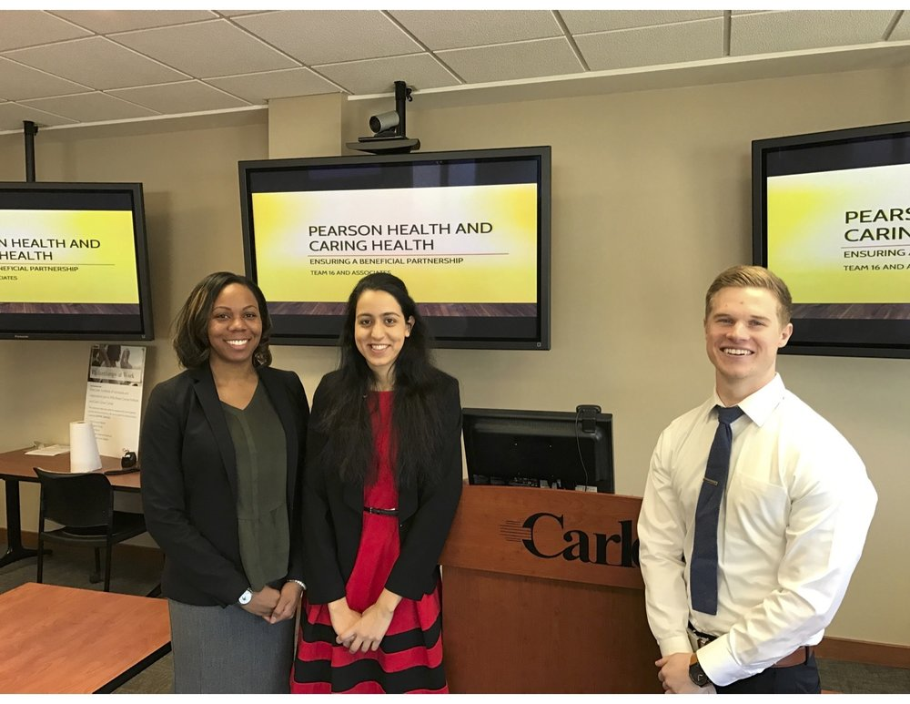 2016 Loyola Transactional Moot Court Team members Amanda Ray, Sarah Ahmed, and Daniel Walbright