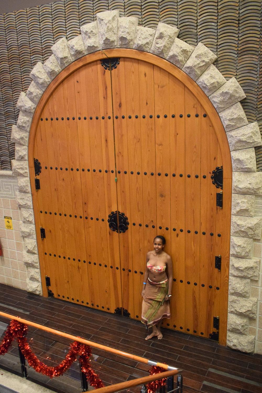Shiko posing by this grand door