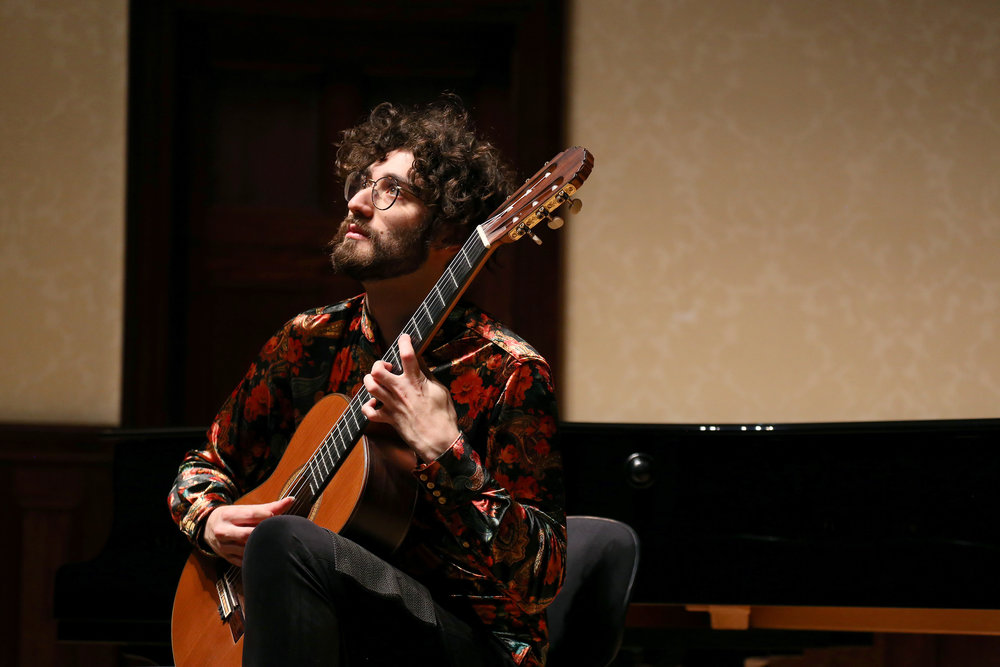 """""""His concerts are communicative, eccentric and have been described as truly beautiful and professional. He brings a new identity to traditional repertoire as well as verve and dynamism to contemporary and lesser-known works."""" -"""