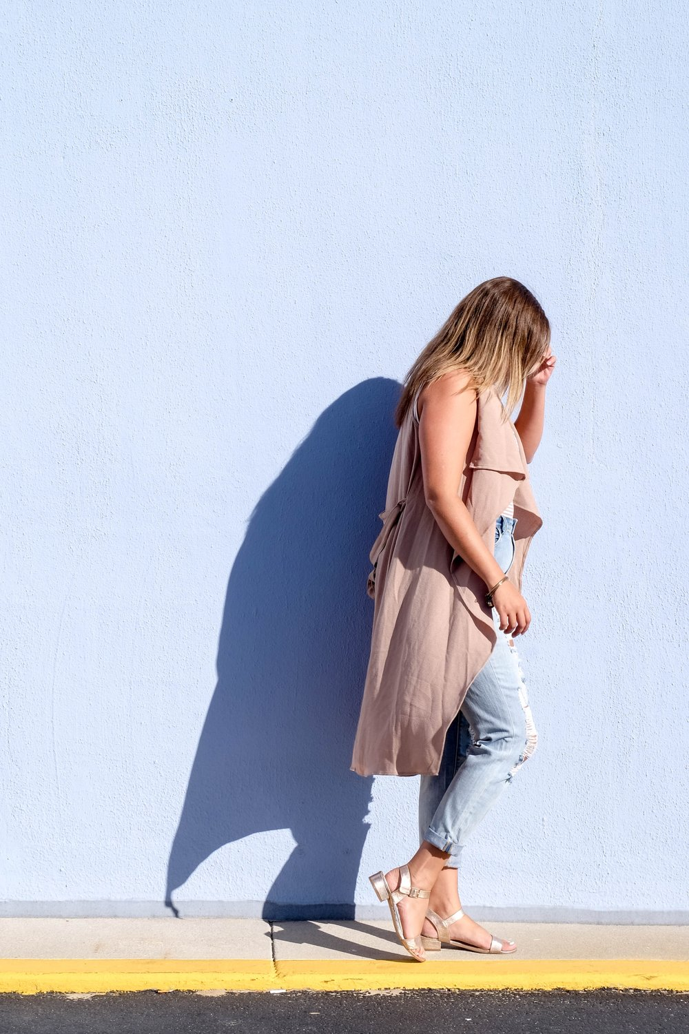 brown sleeveless duster ripped denim look