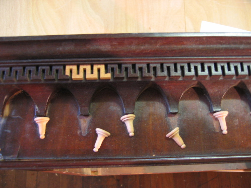 Small turnings and molding were replicated and replaced.