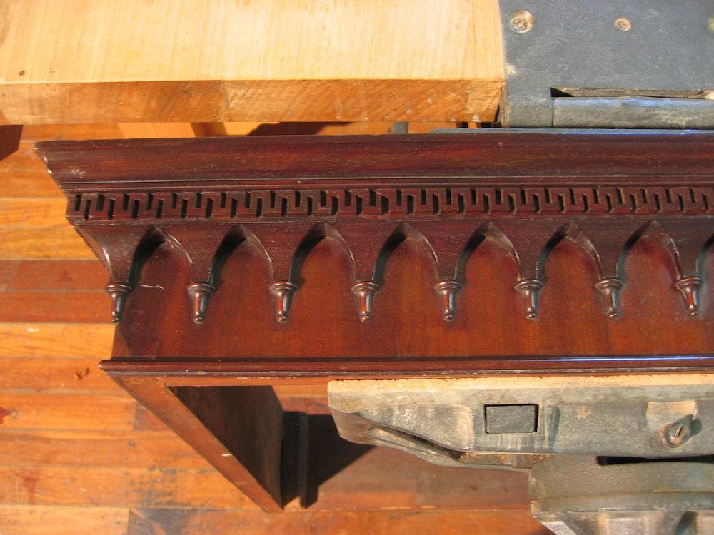 The repaired cornice.
