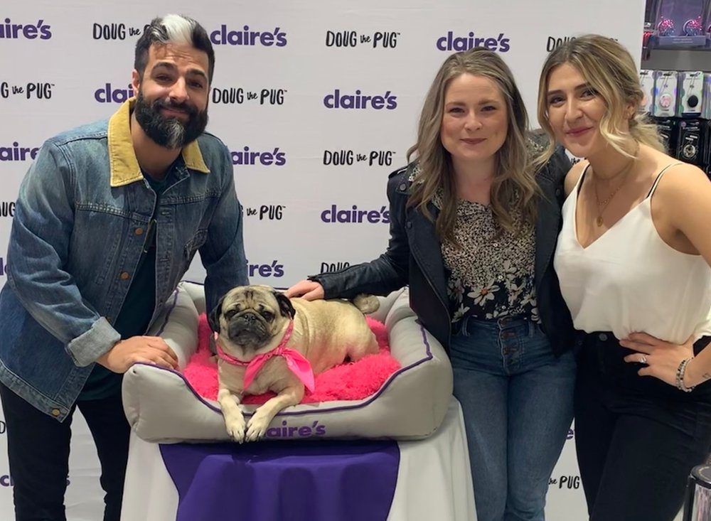 With Leslie Mosier, her husband Rob Chianelli, and none other than Doug the Pug at a Claire's meet and greet event in Nashville.