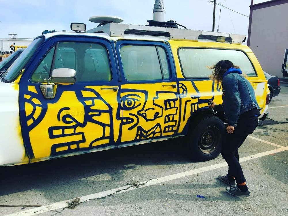 Local Artist, Ruby Jo, spray painting Gemma at the 2019 Reno Punk Rock Flea Market.
